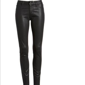 Articles of Society leather coated skinny jeans.